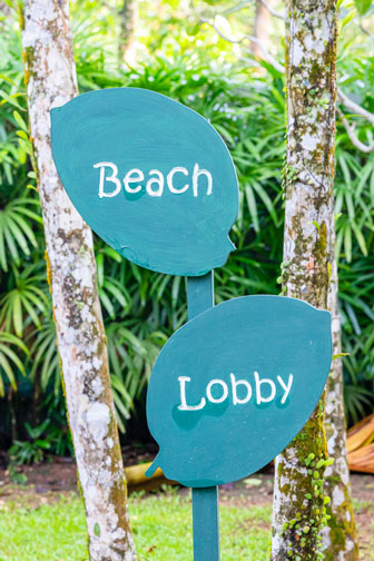 signs to the beach and the hotel lobby
